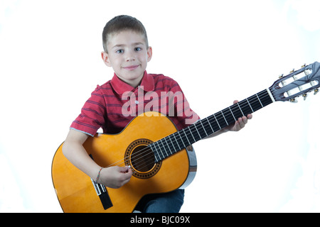 Young Boy Playing Classical Guitar Isolated on White