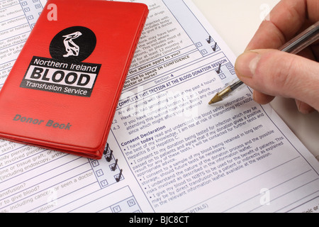 Completing a consent form for the blood transfusion service - Stock Photo