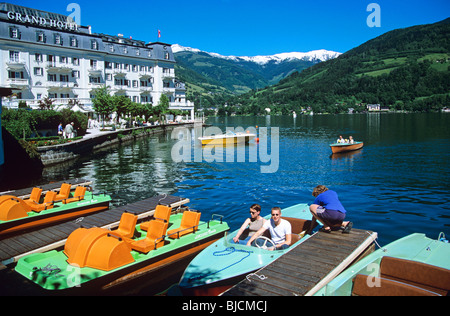 Boating on the lake near the Grand Hotel in the popular lakeside resort of Zell am See - Stock Photo