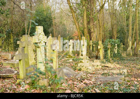 Highgate Cemetery , London , random headstones & graves in disrepair - Stock Photo