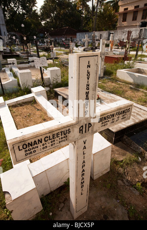 India, Kerala, Kochi, Vypeen Island, Portuguese colonial Church of Our Lady of Hope, cemetery christian graves - Stock Photo