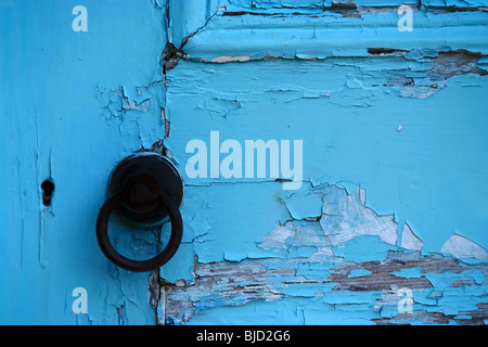 Paint peeling from an old door. Turquoise colour, color - Stock Photo