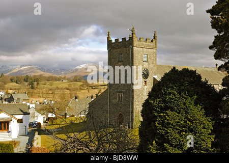 St Michael and All Angels Church overlooking Hawkshead and the surrounding fells, Lake District, England - Stock Photo