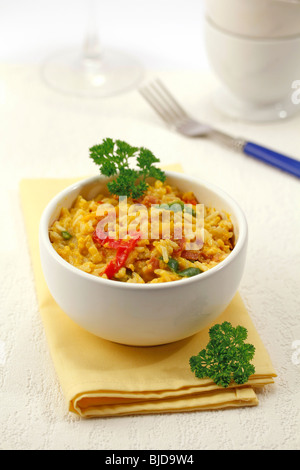 Scrambled eggs with rice and ham. Recipe available. - Stock Photo