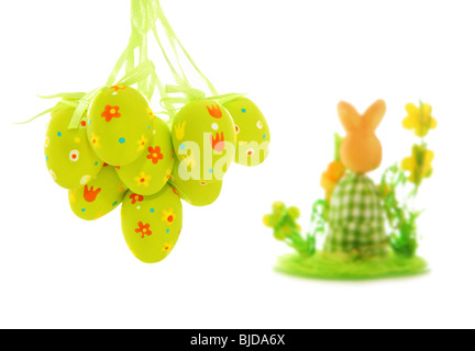 Easter eggs and bunny over white background - Stock Photo