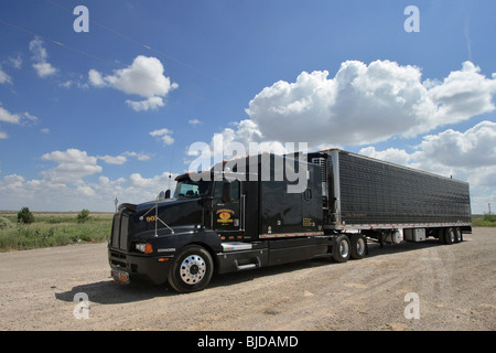 A black truck on a sandy parking lot on the steppe in New Mexico, USA - Stock Photo