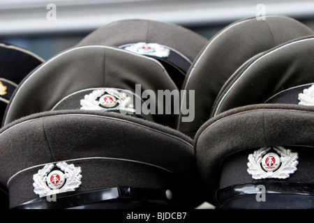 National People's Army military hats - Stock Photo