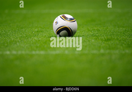 Jabulani, official matchball of th FIFA Football World Cup 2010 in South Africa on  green pitch - Stock Photo