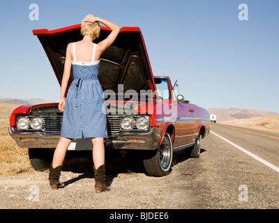 Woman having car trouble. - Stock Photo