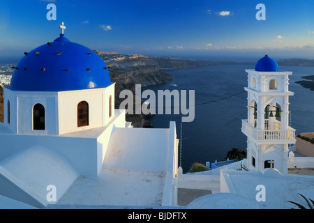 Sunset view onto the caldera from the village of Imerovigli, Santorini Island, Greece. - Stock Photo