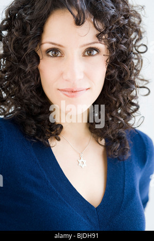 woman wearing a star of david necklace - Stock Photo