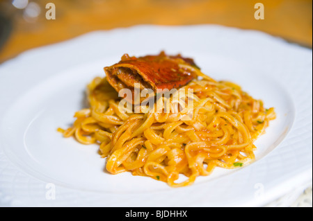 Fettuccine pasta with lobster sauce - Stock Photo