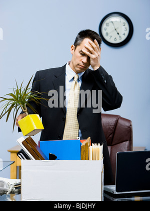 businessperson clearing out things - Stock Photo
