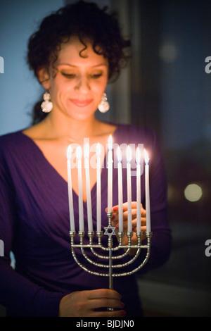 Woman with a menorah - Stock Photo