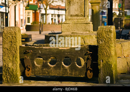 Stocks (dating from 1351) and base of cross in Market Square, Poulton-le-Fylde, Lancashire, England
