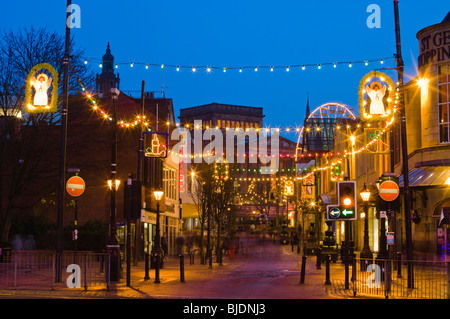 Christmas lights in Friargate, Preston, Lancashire, looking towards the Harris Museum and Art Gallery - Stock Photo