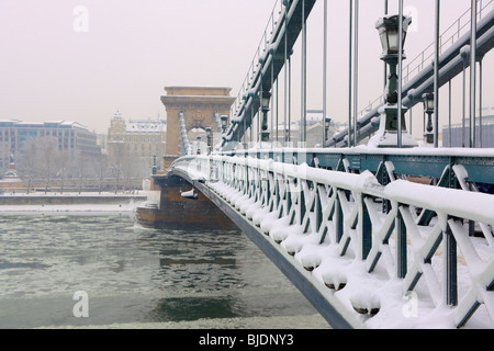 Szechenyi Chain Bridge (Széchenyi lánchíd) in a snow storm, crossing the Danube, Budapest, Hungay - Stock Photo