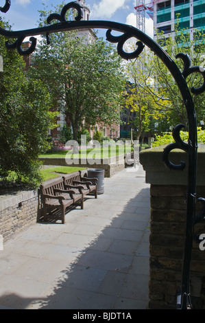 iron gate to the rear of St Botolph's Church, Aldgate, London - Stock Photo
