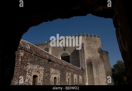 The back of the church of the ex convent San Agustin Acolman is seen trought a window in Acolman, Mexico City - Stock Photo