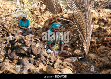 Native Kerala Women Working in the extraction of coir from coconut Husk in Small scale Coir Industry at Kerala India - Stock Photo