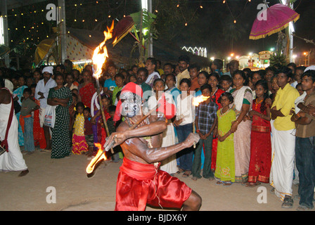 Furious and Dangerous Fire Dance .A scene from Hindu Festival of Kerala,India - Stock Photo