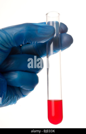 gloved hand holding test tube - Stock Photo