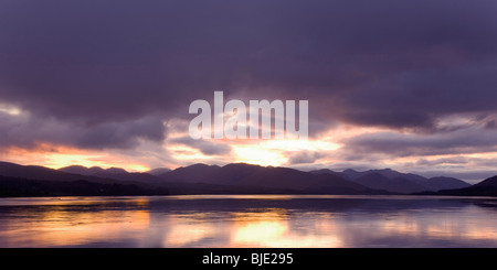 Corpach, Highland, Scotland. Panoramic view westwards along Loch Eil at sunset, stormy sky. - Stock Photo