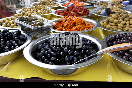 Bowls of olives on display at Farmers Market in Brighton UK - Stock Photo