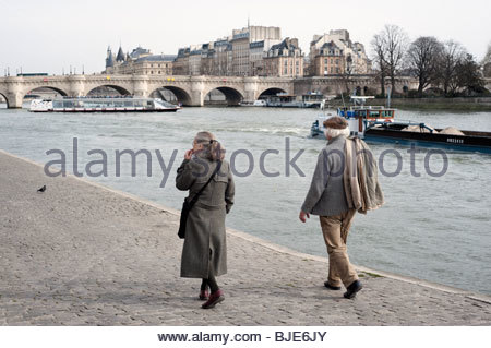 Senior couple walking along Seine river, Paris, France, - Stock Photo