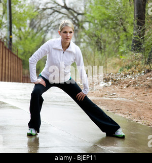 woman stretching before a workout - Stock Photo