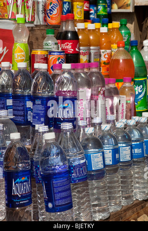 India, Kerala, Varkala, tourist shop selling bottled drinking water and soft drinks in plastic bottles - Stock Photo