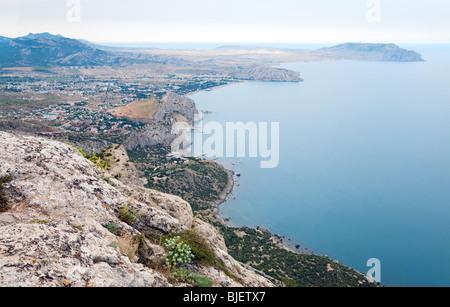 View on summer rocky coastline of 'Sudak' Town (Crimea, Ukraine) - Stock Photo