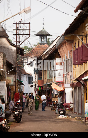 India, Kerala, Kochi, Mattancherry, Jewtown, road to old Jewish Synagogue with tourist shops disfigured by electrical - Stock Photo