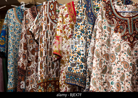 India, Kerala, Kochi, Mattancherry, Jewtown, paisley patterned cothes on display in tourist shop - Stock Photo