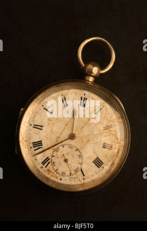 An old gold pocket watch. - Stock Photo