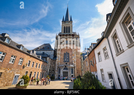 Aachen Dom cathedral, Aachen, Germany (also know as Aix-la-Chapelle), with tourists outside the entrance - Stock Photo