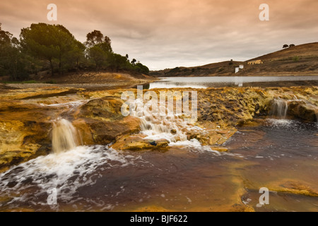Rio Tinto over the mill Gadea - Huelva - Spain - Stock Photo