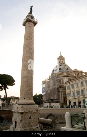 Italy, Rome, Colonna Traiana (Trajan's Column) Monumento a Vittorio Emanuele II in the background - Stock Photo