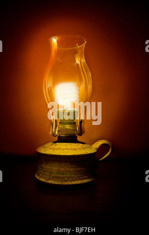Energy saving sustainability light bulb in oil lamp - Stock Photo