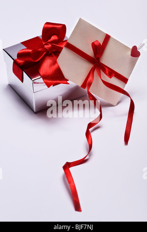 decorative silver gift with envelope isolated on white background - Stock Photo