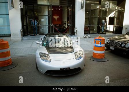 Tesla roadster outside the tesla motors showroom in the trendy stock