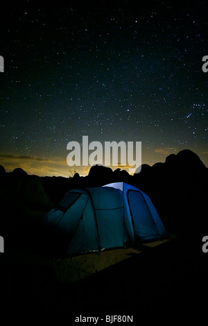 A tent under a night sky with stars - Stock Photo