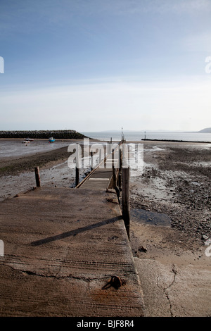 View along slipway and jetty at low tide at Rhos on Sea, North Wales - Stock Photo