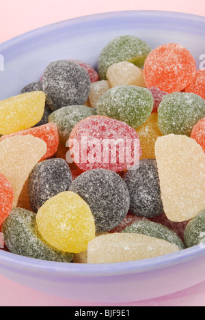Assorted fruit-flavoured pastilles in a bowl. - Stock Photo