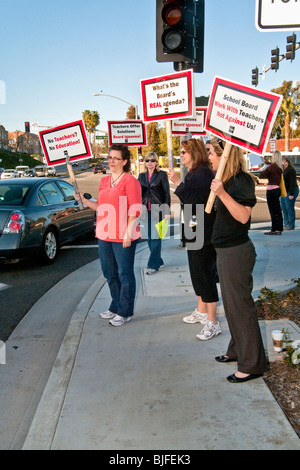Teachers stage a street corner picket against a threatened pay cut by the city school board Mission Viejo, California. - Stock Photo