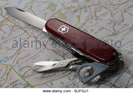 Open Swiss Army knife on map, Dorset, England - Stock Photo