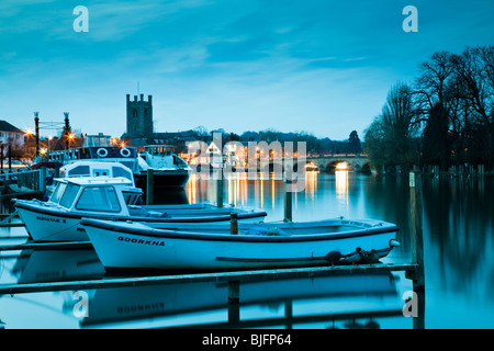 Dusk descendes over Henley on Thames in Oxfordshire from the boat hire bank, Uk - Stock Photo