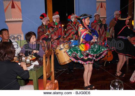 Inca dancers and musicians perform in a restaurant, Cuzco, Peru - Stock Photo