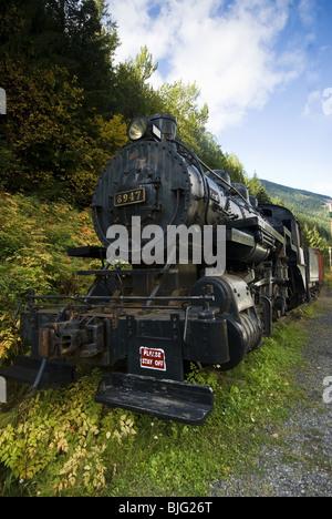 Old disused stream train in British Columbia, Canada. - Stock Photo