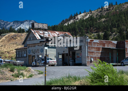 Old rusty gas station somewhere in British Columbia - Stock Photo